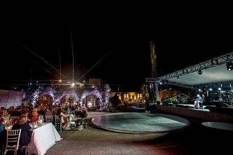 Circular dancefloor at Santorini wedding by Invisible Blue