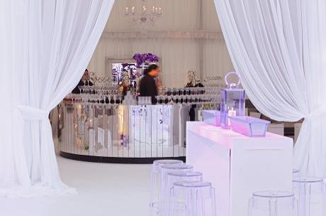 Romantic wedding with white drapes and metallic circular bar