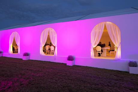Dramatic purple lighting on wedding marquee